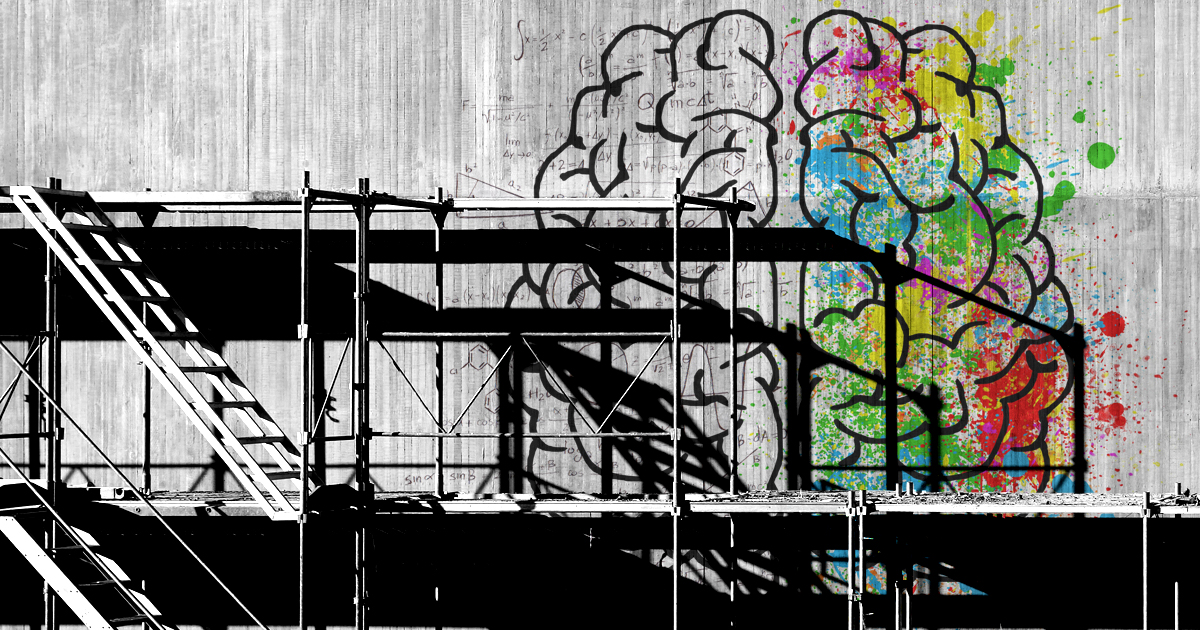 Image of a brain on a concrete wall with scaffolding in front of it.