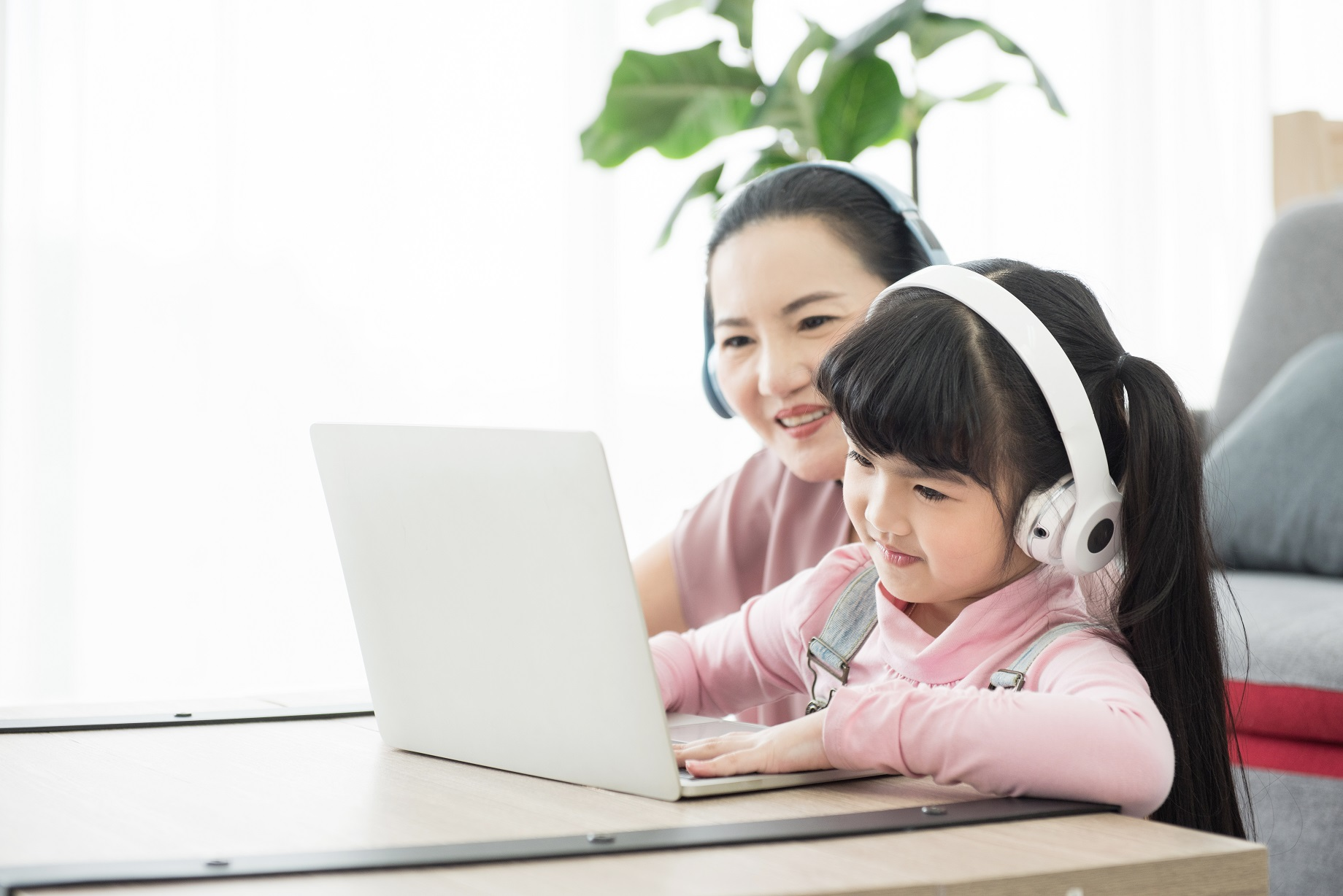 asian girl studying with laptop and headset ,correspondence cour